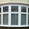 Doors, windows and their frames and thresholds for doors, of plastics