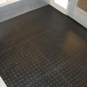 Floor coverings of polymers of vinyl chloride, whether or not self-adhesive, in rolls or in the form of tiles