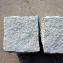 Tiles, cubes and other processed articles of natural stone, incl. slate, for mosaics and the like, whether or not rectangular or square, the largest surface area of which is capable of being enclosed in a square of side of < 7 cm; artificially coloured granules, chippings and powder of natural stone, incl. slate