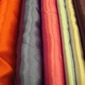 Woven fabrics of yarn containing >= 85% synthetic filament by weight, incl. monofilament of >= 67 decitex and a maximum diameter of <= 1 mm, made of yarn of different colours