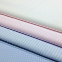Plain woven fabrics containing predominantly, but < 85% polyester staple fibres by weight, mixed principally or solely with cotton and weighing <= 170 g/m², dyed
