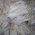 Yarn containing > 50% to < 85% polyester staple fibres by weight, mixed principally or solely with wool or fine animal hair